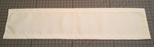 Hemmed white curtain.