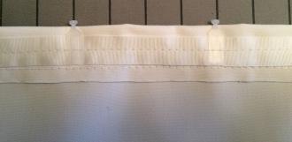 Tab tape sewn in.